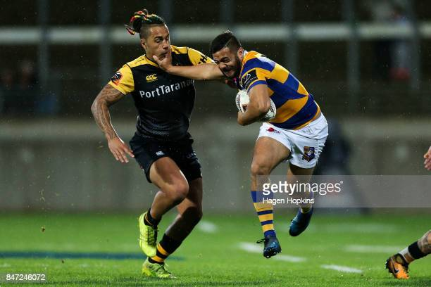 Chase Tiatia of Bay of Plenty fends Sean Wainui of Taranaki during the round five Mitre 10 Cup match between Taranaki and Bay of Plenty at Yarrow...