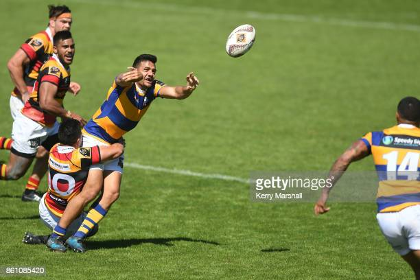Chase Tiatia of Bay of Plenty gets a pass away on the tackle of Sam Christie of Waikato during the round nine Mitre 10 Cup match between Bay of...