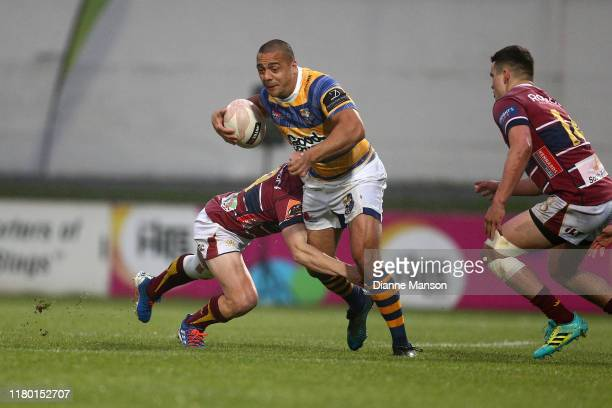 Chase Tiatia of the Bay of Plenty Steamers is tackled during the round 10 Mitre 10 Cup match between Southland and Bay of Plenty at Rugby Park on...