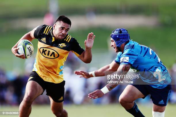 Chase Tiatia of the Hurricanes beats the tackle from Daniel Kirkpatrick of the Blues during the Super Rugby trial match between the Blues and the...