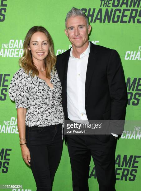 Chase Utley and Jennifer Cooper attend the LA Premiere Of The Game Changers at ArcLight Hollywood on September 04 2019 in Hollywood California