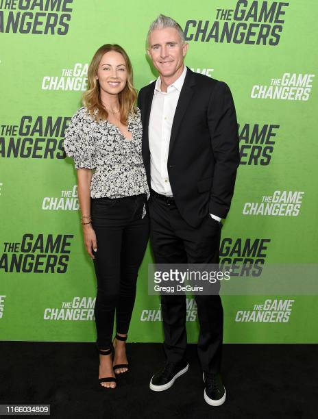 Chase Utley and Jennifer Utley arrive at the LA Premiere Of The Game Changers at ArcLight Hollywood on September 4 2019 in Hollywood California