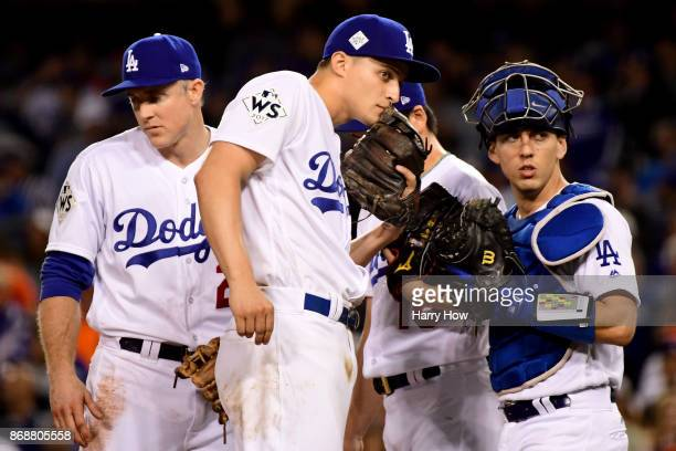 Chase Utley Corey Seager Kenta Maeda and Austin Barnes of the Los Angeles Dodgers meet on the pitcher's mound during the seventh inning against the...