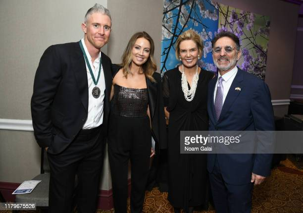 Chase Utley Jennifer Cooper and Lesley Visser attend the Legends Reception during the 34th Annual Great Sports Legends Dinner To Benefit The...