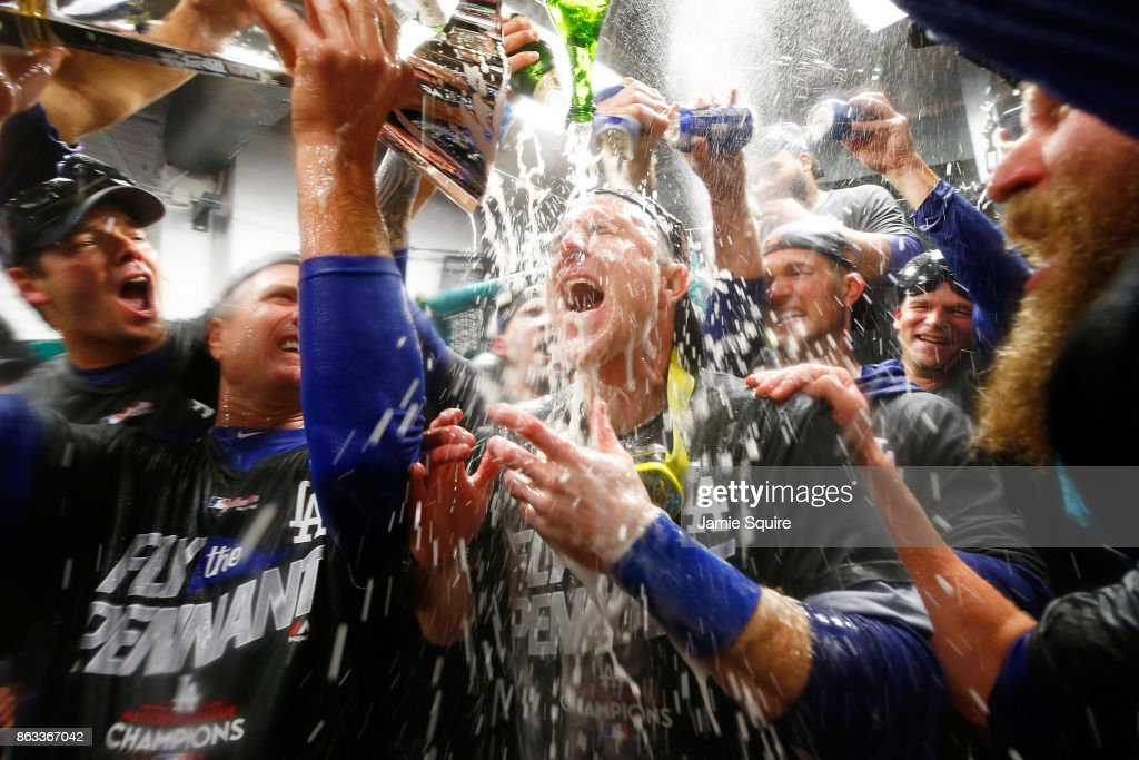 Chase Utley #26 of the Los Angeles Dodgers celebrates in the clubhouse after defeating the Chicago Cubs 11-1 in game five of the National League Championship Series at Wrigley Field on October 19, 2017 in Chicago, Illinois. The Dodgers advance to the 2017 World Series.
