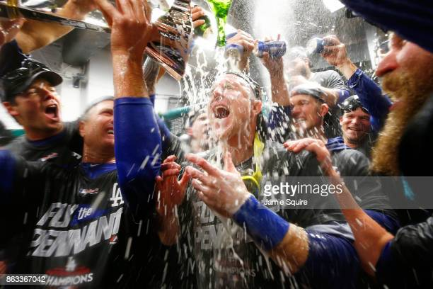Chase Utley of the Los Angeles Dodgers celebrates in the clubhouse after defeating the Chicago Cubs 111 in game five of the National League...