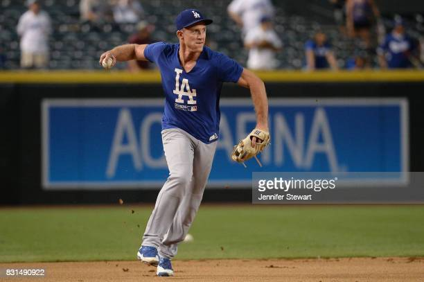 Chase Utley of the Los Angeles Dodgers fields ground balls during batting practice before the MLB game against the Arizona Diamondbacks at Chase...