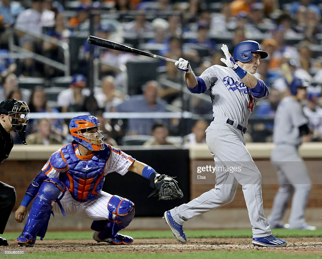 Chase Utley #26 of the Los Angeles Dodgers hits a grand slam as Rene Rivera #44 of the New York Mets defends in the seventh inning at Citi Field on May 28, 2016 in the Flushing neighborhood of the Queens borough of New York City.