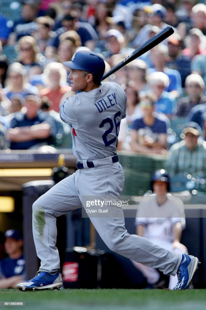 Chase Utley #26 of the Los Angeles Dodgers hits a single in the third inning against the Milwaukee Brewers at Miller Park on June 3, 2017 in Milwaukee, Wisconsin.