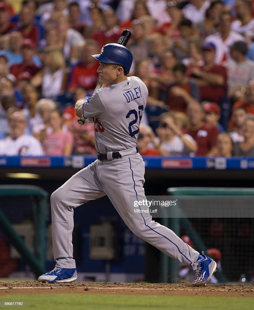 Chase Utley #26 of the Los Angeles Dodgers hits a solo home run in the top of the fifth inning against the Philadelphia Phillies at Citizens Bank Park on August 16, 2016 in Philadelphia, Pennsylvania. The Dodgers defeated the Phillies 15-5.