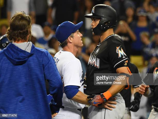 Chase Utley of the Los Angeles Dodgers holds back Giancarlo Stanton of the Miami Marlins as benches cleared in the eighth inning of the game at...