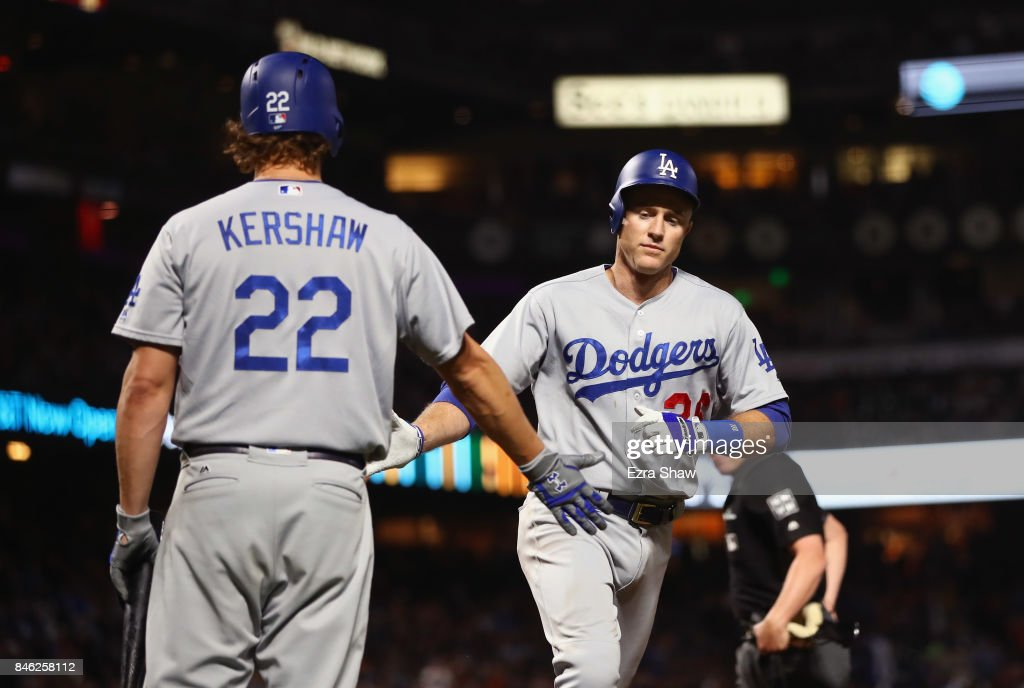 Chase Utley #26 of the Los Angeles Dodgers is congratulated by Clayton Kershaw #22 after he hit a home run in the fourth inning against the San Francisco Giants at AT&T Park on September 12, 2017 in San Francisco, California.