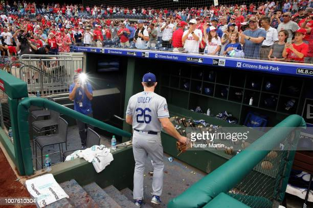Chase Utley of the Los Angeles Dodgers is photographed by team photographer Jon SooHoo as he leaves the field after saying goodbye to the fans after...