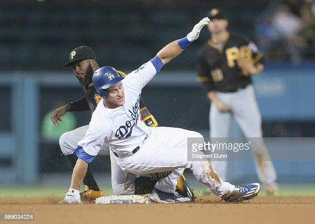 Chase Utley of the Los Angeles Dodgers is tagged out at second by second baseman Josh Harrison of the Pittsburgh Pirates as he tries to advance after...
