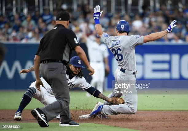 Chase Utley of the Los Angeles Dodgers is tagged out by Freddy Galvis of the San Diego Padres as he tries to steal second base during the third...