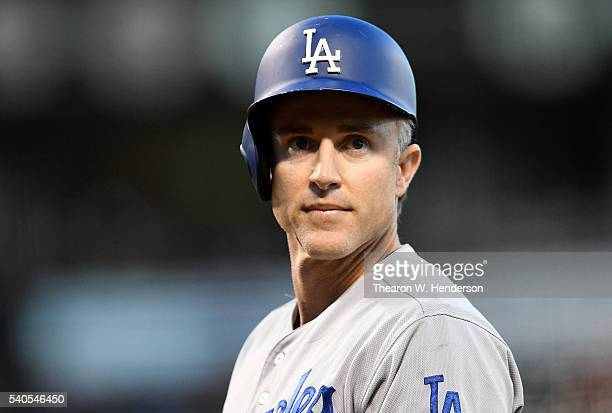 Chase Utley of the Los Angeles Dodgers looks on after he was hit by a pitch from Johnny Cueto of the San Francisco Giants in the top of the fifth...