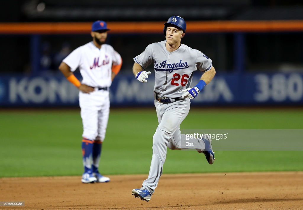 Chase Utley #26 of the Los Angeles Dodgers rounds the bases as Amed Rosario #1 of the New York Mets looks on after Utley hit a two run home run in the sixth inning against the New York Mets on August 4, 2017 at Citi Field in the Flushing neighborhood of the Queens borough of New York City.