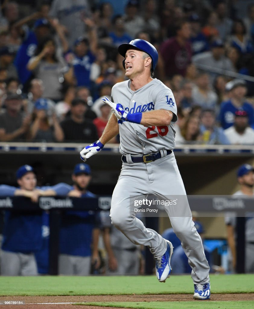 Chase Utley #26 of the Los Angeles Dodgers runs as he scores during the eighth inning of a baseball game against the San Diego Padres at PETCO Park on July 11, 2018 in San Diego, California.