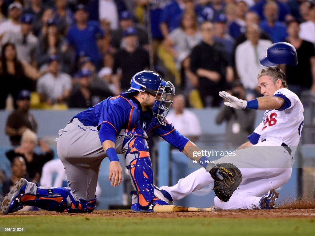 Chase Utley #26 of the Los Angeles Dodgers slides ahead of a tag from Travis d'Arnaud #18 of the New York Mets to score and take an 8-4 lead during the sixth inning at Dodger Stadium on June 19, 2017 in Los Angeles, California.