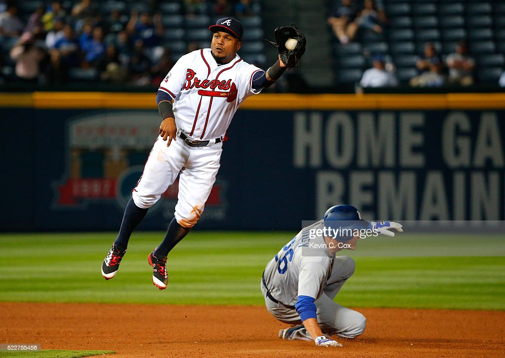 Chase Utley #26 of the Los Angeles Dodgers steals second base under Erick Aybar #1 of the Atlanta Braves in the 10th inning at Turner Field on April 20, 2016 in Atlanta, Georgia.