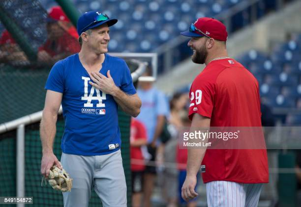 Chase Utley of the Los Angeles Dodgers talks to Cameron Rupp of the Philadelphia Phillies prior to the game at Citizens Bank Park on September 18...