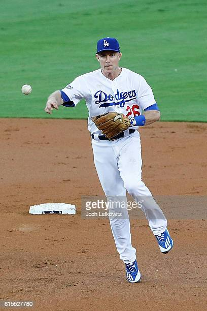 Chase Utley of the Los Angeles Dodgers throws out a runner against the Chicago Cubs in the second inning of game three of the National League...