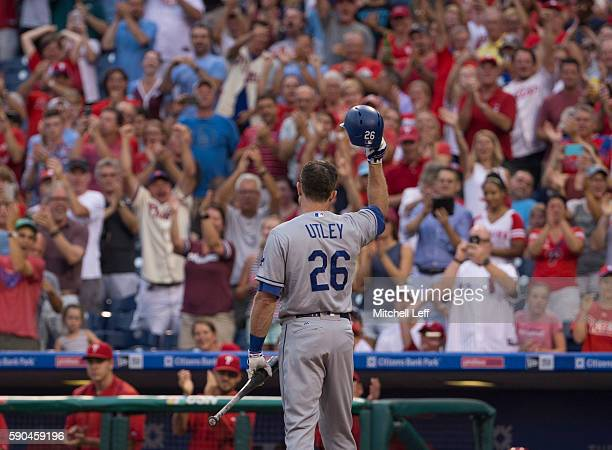 Chase Utley of the Los Angeles Dodgers tips his hat to the crowd prior to his at bat in the first inning against the Philadelphia Phillies at...