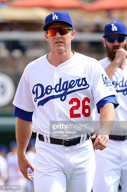 Chase Utley of the Los Angeles Dodgers walks to the dugout prior to the spring training game against the Arizona Diamondbacks at Camelback Ranch on...