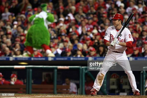 Chase Utley of the Philadelphia Phillies bats against the New York Yankees as the Philly Phanatic watches from the top of the dugout in Game Five of...