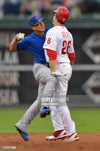 Chase Utley of the Philadelphia Phillies breaks up a double play attempt by Darwin Barney of the Chicago Cubs in the first inning at Citizens Bank...