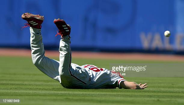 Chase Utley of the Philadelphia Phillies dives for a fly ball during 41 victory over the Los Angeles Dodgers at Dodger Stadium on Sunday August 8 2004