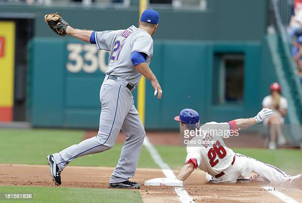 Chase Utley of the Philadelphia Phillies dives into first base beating the throw Lucas Duda of the New York Mets during the first inning at Citizens...