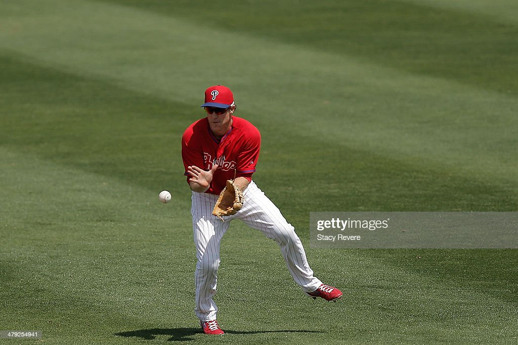 Chase Utley #26 of the Philadelphia Phillies fields a ball in the second inning of a game against the Pittsburgh Pirates at Bright House Field on March 16, 2014 in Clearwater, Florida. Pittsburgh won the game 5-0.