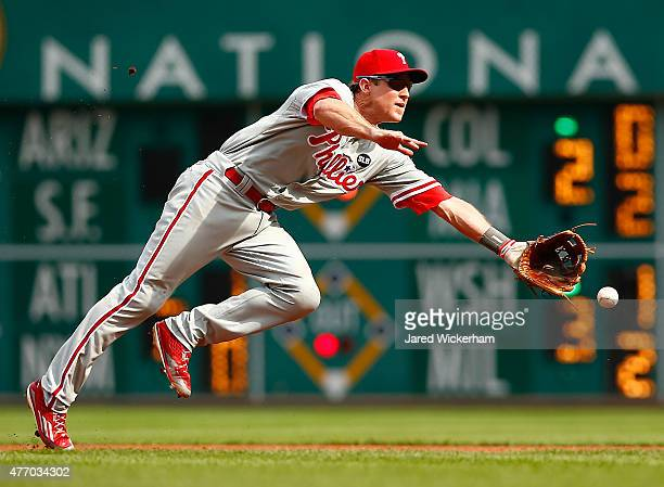 Chase Utley of the Philadelphia Phillies flips the ball to first base with his glove in the second inning against the Pittsburgh Pirates during the...