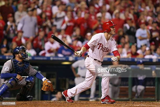 Chase Utley of the Philadelphia Phillies hits a 2-run home run in the bottom of the sixth inning to tie the game 2-2 against the Los Angeles Dodgers...