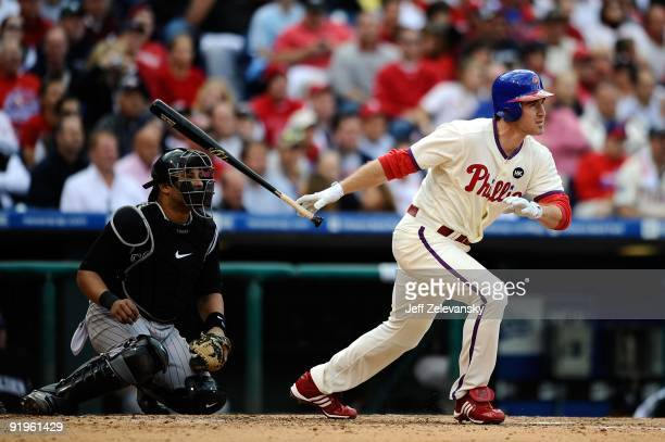Chase Utley of the Philadelphia Phillies hits a single in the bottom of the sixth inning against the Colorado Rockies in Game One of the NLDS during...