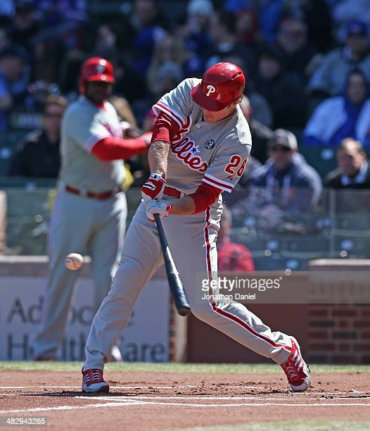 Chase Utley of the Philadelphia Phillies hits a solo home run in the 1st inning against the Chicago Cubs at Wrigley Field on April 5 2014 in Chicago...
