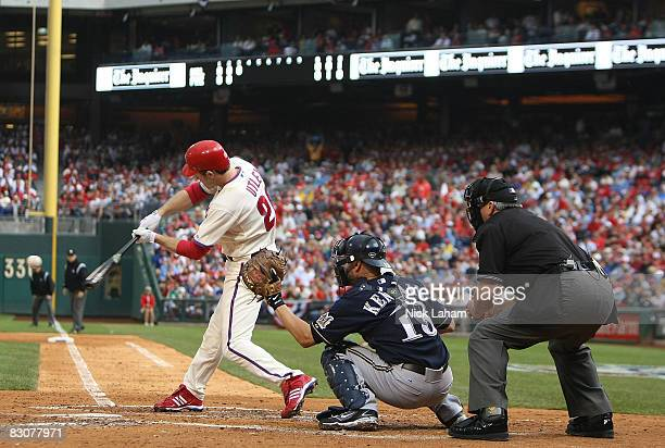 Chase Utley of the Philadelphia Phillies hits an RBI double in the third inning against the Milwaukee Brewers during Game 1 of the NLDS Playoffs at...