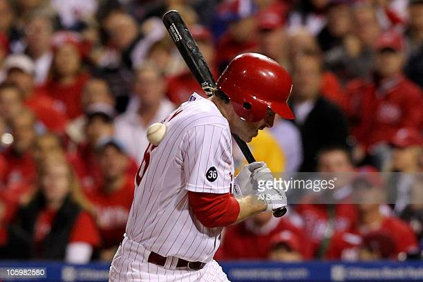 Chase Utley of the Philadelphia Phillies is hit by a pitch in the third inning against the San Francisco Giants in Game Six of the NLCS during the...