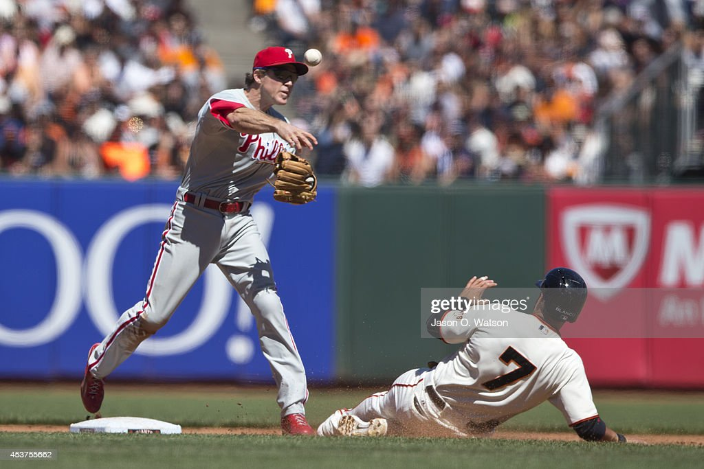 Chase Utley #26 of the Philadelphia Phillies is unable to complete a double play over Gregor Blanco #7 of the San Francisco Giants during the sixth inning at AT&T Park on August 17, 2014 in San Francisco, California.