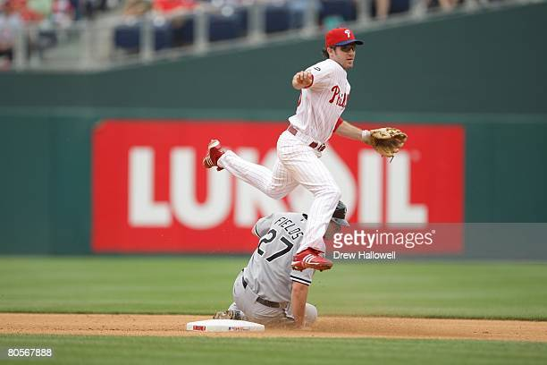 Chase Utley of the Philadelphia Phillies jumps over Josh Fields Chicago White Sox after getting him out a second on June 13 2007 at Citizens Bank...