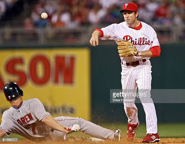 Chase Utley of the Philadelphia Phillies puts out J.D. Drew of the Boston Red Sox at second base on a double play at Citizens Bank Park June 16, 2008...