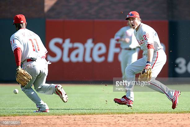 Chase Utley of the Philadelphia Phillies reacts after allowing an infield hit by Freddy Sanchez of the San Francisco Giants in Game Three of the NLCS...