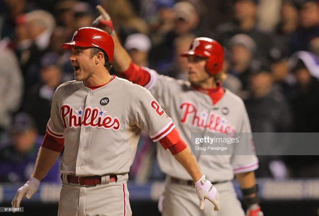 Chase Utley #26 of the Philadelphia Phillies reacts after scoring the game tying run against the Colorado Rockies in the top of the ninth inning in Game Four of the NLDS during the 2009 MLB Playoffs at Coors Field on October 12, 2009 in Denver, Colorado.