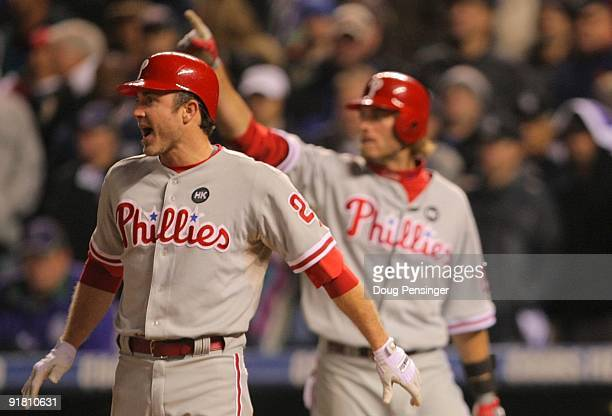 Chase Utley of the Philadelphia Phillies reacts after scoring the game tying run against the Colorado Rockies in the top of the ninth inning in Game...