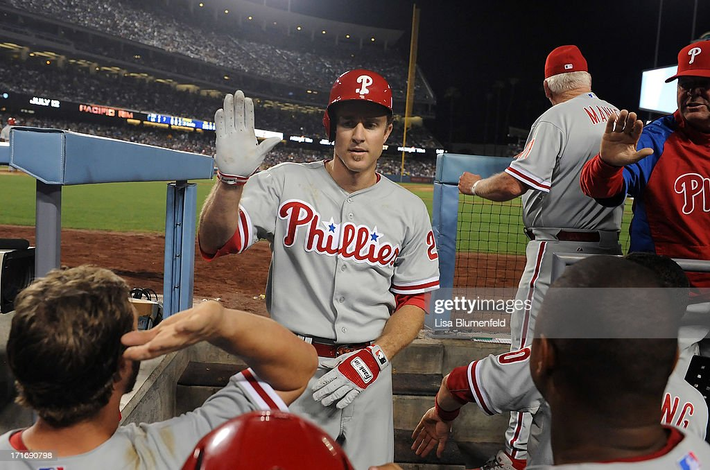 Chase Utley #26 of the Philadelphia Phillies returns to the dugout after hitting a homerun in the seventh inning against the Los Angeles Dodgers at Dodger Stadium on June 27, 2013 in Los Angeles, California.