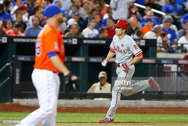 Chase Utley of the Philadelphia Phillies runs the bases after his seventh inning grand slam against Josh Edgin of the New York Mets at Citi Field on...