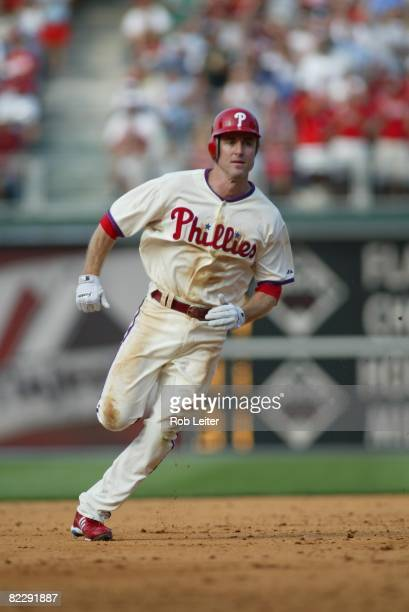 July 26: Chase Utley of the Philadelphia Phillies runs to third base during the game against the Atlanta Braves at Citizens Bank Park in...