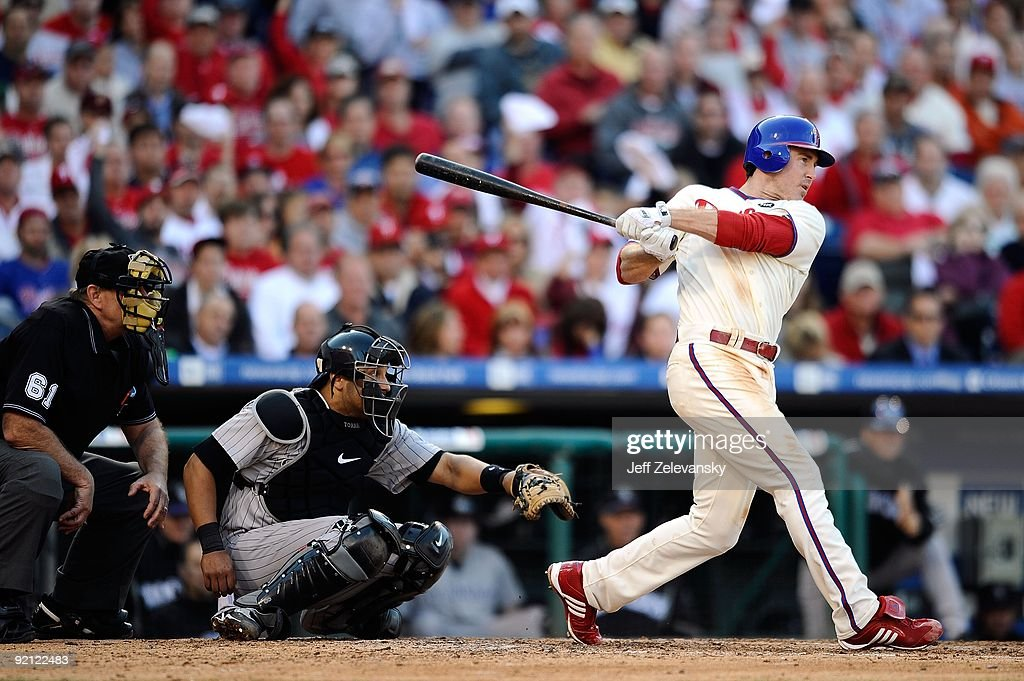 Chase Utley #26 of the Philadelphia Phillies singles in the bottom of the sixth inning against the Colorado Rockies in Game Two of the NLDS during the 2009 MLB Playoffs at Citizens Bank Park on October 8, 2009 in Philadelphia, Pennsylvania. The Rockies won 5-4.
