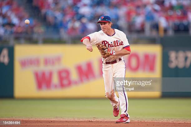 Chase Utley of the Philadelphia Phillies throws after fielding the ball during the game against the Miami Marlins at Citizens Bank Park on September...